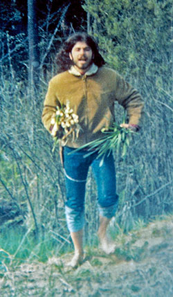 John Kallas emerging from a Michigan swamp with cattail shoots in 1973.